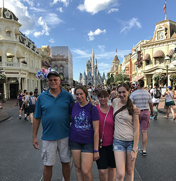 Lynne with family in Disney World pic